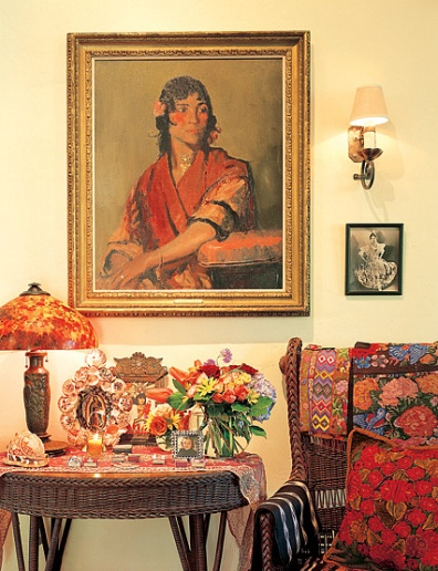 caption: Ronstadt acquired the painting in the living room by Robert Henri because it reminded her of her aunt Luisa Espinel, a traditional Spanish singer and dancer. Espinel, whose photograph hangs at right, performed with famed Spanish guitarist Andres Segovia in the 1920s.