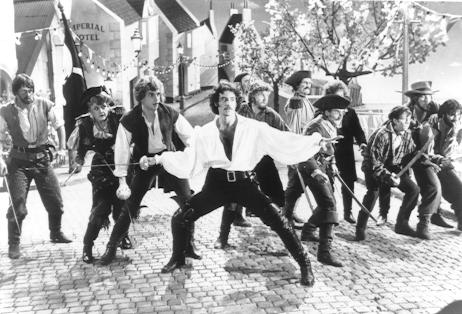 Kevin Kline as the Pirate King in Pirates of Penzance strikes an extremely heroic (in the Blackadder sense) pose as he leads his motley crew (including Angela Lansbury).  His thigh high boots look mighty fine.